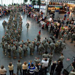 Indiana Army National Guard Soldiers with the 76th Infantry Brigade Combat Team march into the Indianapolis International Airport in Indianapolis. Staff Sgt. Jeff Lowry/Indiana National Guard