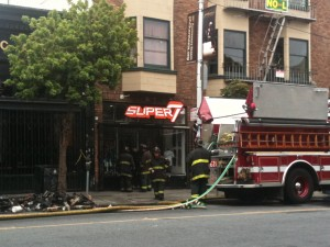 Firefighters investigate toy and t-shirt shop Super 7 in the Haight. Lisa Pickoff-White/KQED