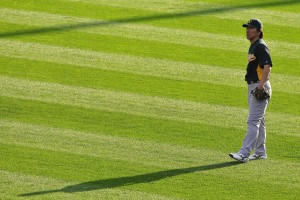 Hideki Matsui stands in the outfield.