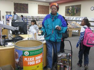 A patron donates food at the East Palo Alto Library. (Photo by: San Mateo County Library)