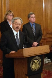 Mayor Ed Lee (center) announces that he will file misconduct charges against Sheriff Ross Mirkarimi and appoints Vicki Hennessy (left) as interim sheriff. (Mina Kim/KQED)