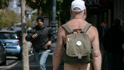 A nudist walks on Market Street in San Francisco. (Kimihiro Hoshino/AFP/Getty Images)