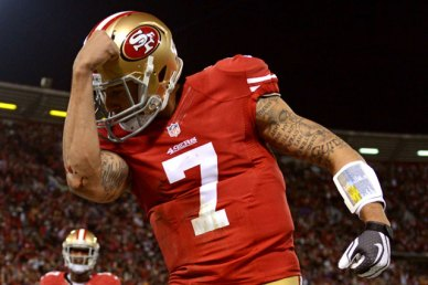 """The creation of """"Kaepernicking."""" San Francisco 49ers QB Colin Kaepernick flexes in the end zone during his team's playoff win over the Green Bay Packers. Photo by Harry How/Getty Images."""
