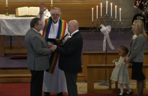 """The Rev. Gordon Hutchins, a United Methodist minister, performs a wedding between Wayne and Michael Simonson in his church in Tacoma, WA. His state had legalized same-sex marriage last November, but he broke the laws of his church, which declare """"the practice of homosexuality is incompatible with Christian teaching. (Adithya Sambamurthy/ Center for Investigative Reporting)"""