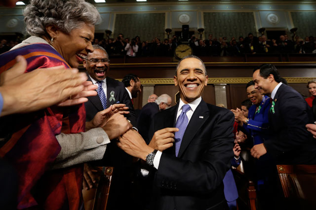 President Barack Obama is greeted before his State of the Union. (Charles Dharapak-Pool/Getty Images)