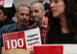 Same-sex couple Frank Capley (L) and Joe Alfano (R) look on before staging a sit-in protest after same-sex couples were denied marriage licenses from the San Francisco county clerk on Valentine's Day. (Justin Sullivan/Getty Images)