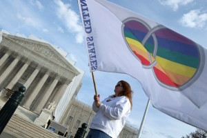 Same-sex marriage proponent Kat McGuckin of Oaklyn, New Jersey, holds a gay marriage pride flag while standing in front of the Supreme Court November 30, 2012 in Washington, D.C. (Chip Somodevilla/Getty Images)
