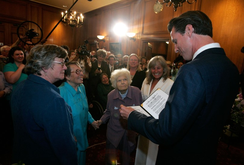 San Francisco mayor Gavin Newsom (R) marries same-sex couple Del Martin (R) and Phyllis Lyon (L) during a private ceremony at San Francisco City Hall June 16, 2008. (Marcio Jose Sanchez-Pool/Getty Images)