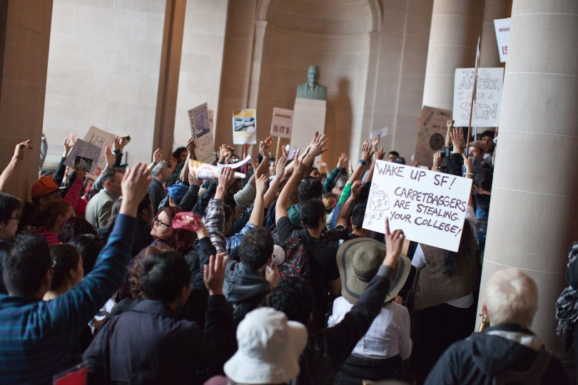 Hundreds of protesters marched into City Hall asking for the mayor to commit to further funding the school. (Deborah Svoboda/KQED)