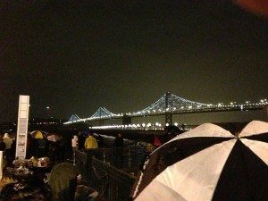 Umbrellas sprouted before the lights came on. (Cy Musiker/KQED)