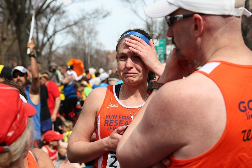 A runner reacts near Kenmore Square after two bombs exploded during the 117th Boston Marathon. (Alex Trautwig/Getty Images)