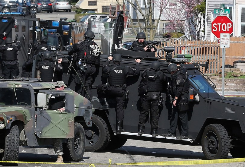 Members of a SWAT team search for 19-year-old bombing suspect Dzhokhar A. Tsarnaev on April 19, 2013 in Watertown, Massachusetts. (Mario Tama/Getty Images)