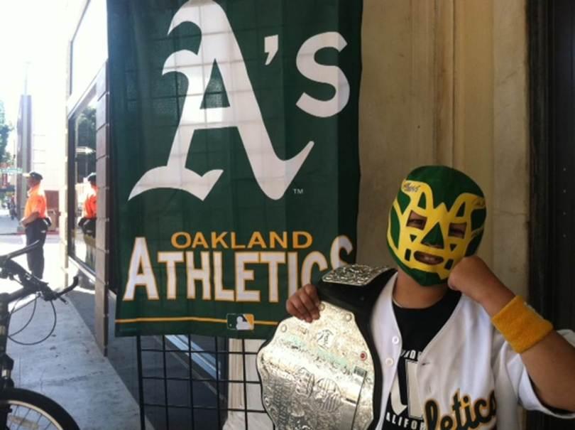 "Gabriel ""The Champ"" Gutierrez, age 8, shows some A's spirit. (Nina Thorsen/KQED)"