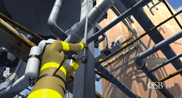 Scene from U.S. Chemical Safety Board Animation of August 2012 Chevron refinery fire: Here, a firefighter uses a steel pike to try to dislodge insulation from a leaking pipe in the crude-processing unit that was soon to catch fire.