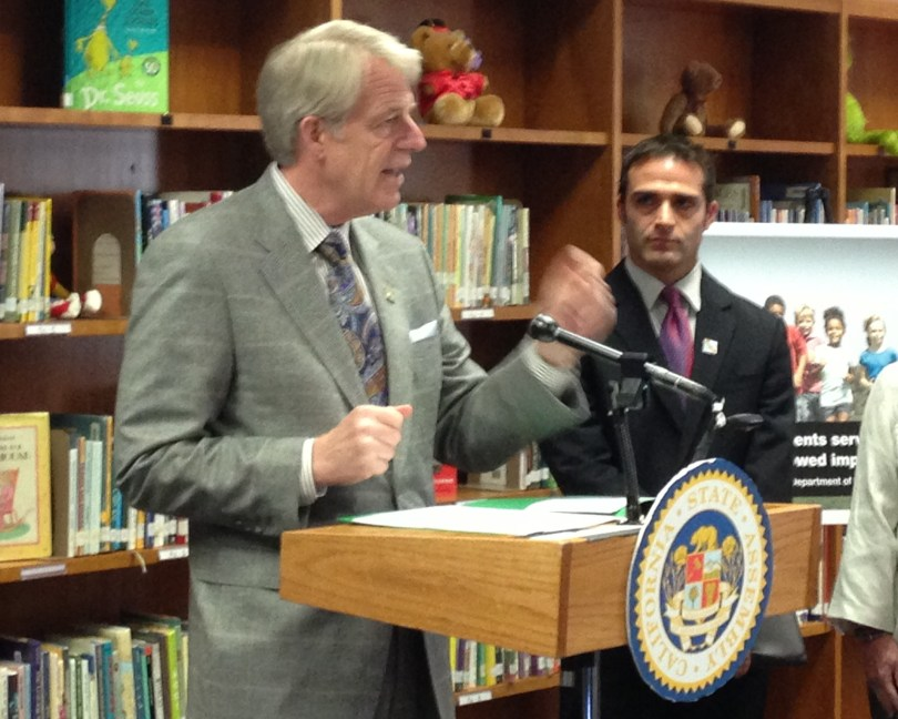 Assembly Democrat Roger Dickinson discusses his proposed ammunition tax at a Sacramento elementary school