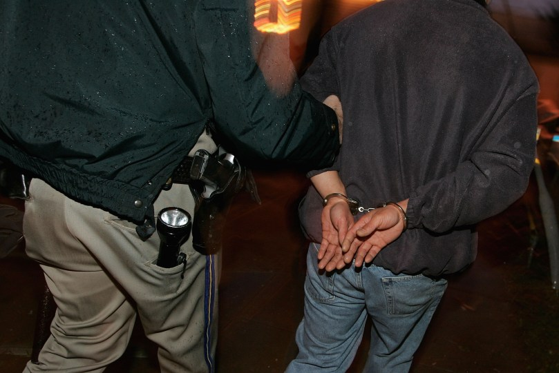 A man is taken away after failing a sobriety test. (Justin Sullivan/Getty Images)