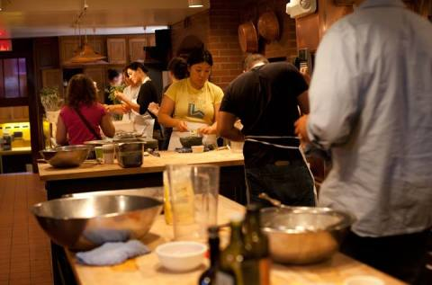 Staff in the Chez Panisse kitchen on Friday June 21 preparing for two fundraising dinners being held at the restaurant and café to benefit the Edible Schoolyard Foundation. (Photo: Emilie Raguso)