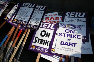 Picket signs sit in a stack outside of BART's Lake Merritt station on the first day of last month's strike. (Justin Sullivan/Getty Images)