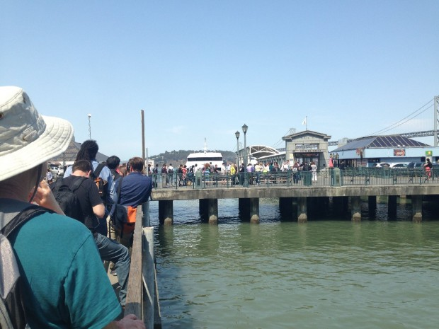 People wait in a long line for ferry to Oakland. (Isabel Angell/KQED)