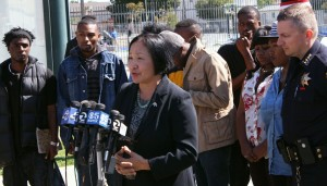 Oakland Mayor Jean Quan, with interim Police Chief Sean Whent and representatives from Youth Uprising, discuss the city's violent crime strategy on Wed, Aug. 8. (Alex Emslie/KQED)