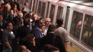 Commuters wait to board a Bay Area Rapid Transit (BART) train during rush hour on October 29, 2009 in San Francisco.  (Photo by Justin Sullivan/Getty Images)