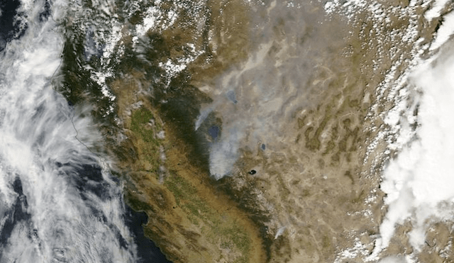 NASA satellite image of smoke from the Rim Fire, in Tuolumne County west of Yosemite National Park, drifting over Lake Tahoe, Reno, and beyond. (NASA Worldview)