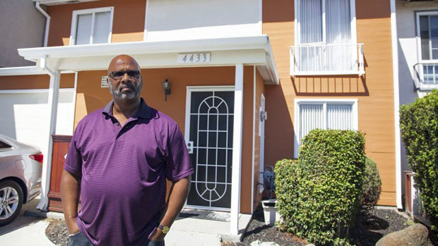 Richmond resident Morris LeGrande, a supporter of the city's eminent domain scheme, stands in front of his home (Mark Andrew Boyer?Richmond Confidential)