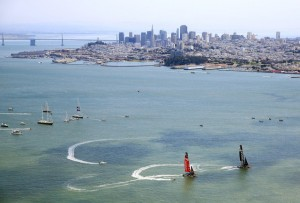 Emirates Team Zew Zealand and Oracle Team USA in pre-race maneuvers on Tuesday.  (Jamie Squire/Getty Images)