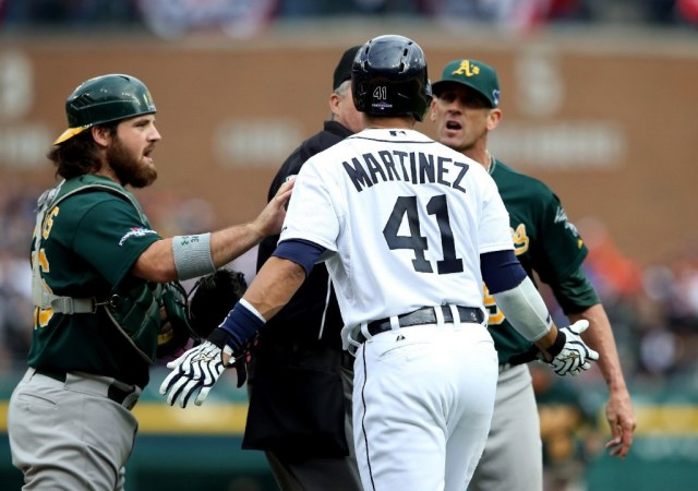 Oakland A's catcher Derek Norris, left, tries to calm Victor Martinez of the Detroit Tigers, who took exception to comments from A's pitcher Grant Balfour, right. (Leon Halip/Getty Images)