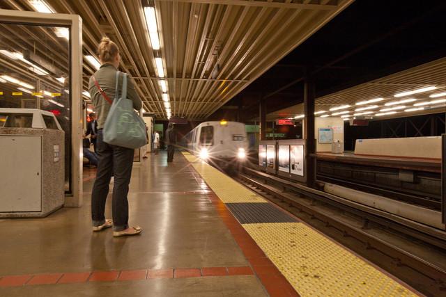 A BART train pulls into the MacArthur station in Oakland. (Deborah Svoboda/KQED)