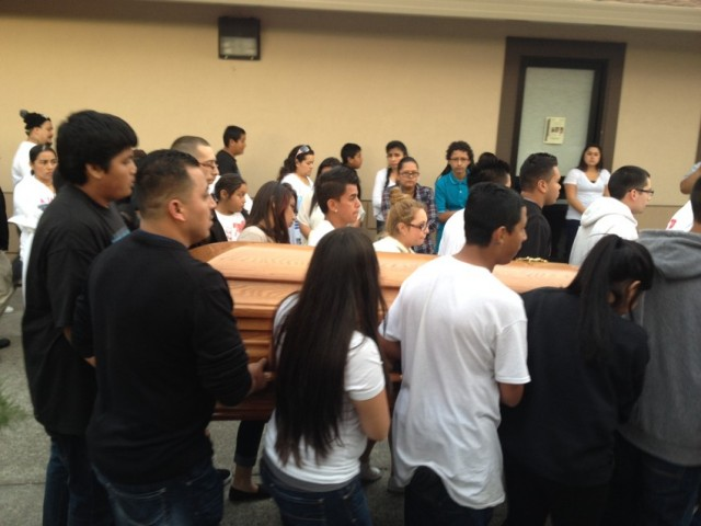 Pallbearers, including many classmates of Andy Lopez, carry his casket into the church. (Rachel Dornhelm/KQED)