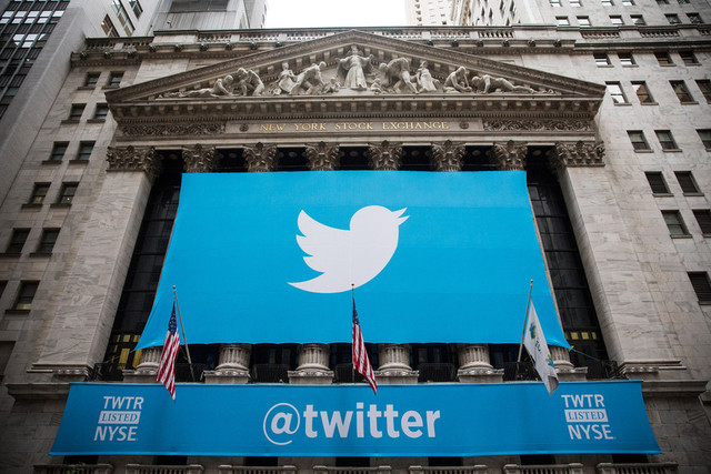 The Twitter logo is displayed on a banner outside the New York Stock Exchange. (Photo by Andrew Burton/Getty Images)