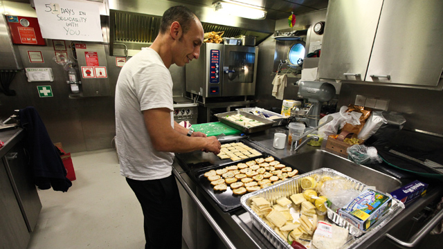 Sophiane Benaouda, a local caterer, prepares dinner in the ships galley for a big event they are hosting that night. The Rainbow Warrior caters to an international crew by offering carnivorous, vegetarian and vegan dish for almost every meal served. (Deborah Svoboda/KQED)