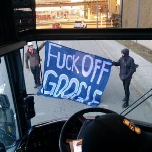 The view from a shuttle bus in West Oakland, headed for Google's Mountain View campus but halted by protesters. (@craigsfrost via Twitter).