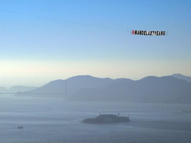 The memorial flight flew over landmarks like Alcatraz Island. (Tawanda Kanhema)