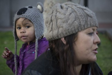 Nyla Bonner, 2, enjoys a free meal with her mother Chelan Cassidy at U.N. Plaza in San Francisco. (Sara Bloomberg/KQED)