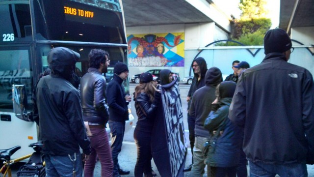 A Google bus halted by protesters Friday morning at Oakland's MacArthur BART station. (Grace Rubenstein/KQED)