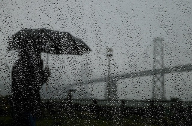 Pedestrian on San Francisco's Embarcadero during Bay Area's first major storm of 2014. (Justin Sullivan/Getty Images)