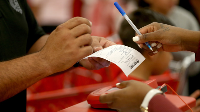 A customer prepares to sign a credit card slip at a Target store on December 19, 2013 in Miami. (Joe Raedle/Getty Images)