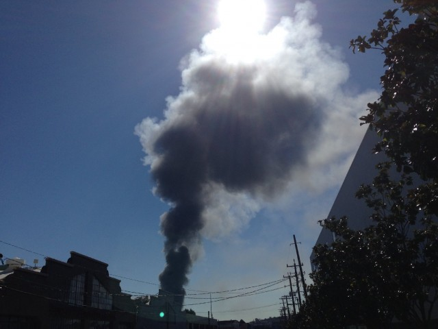 Smoke plume rises from three-alarm fire Monday in San Francisco's Bayview District. (Paul Lancour/KQED).