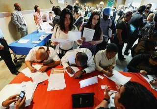 FILE PHOTO: Job seekers at an employment fair. (Kevork Djansezian/Getty Images)