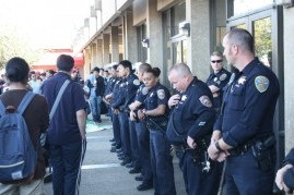 Police from the San Francisco and City College campus police departments block the majority of protesters from entering Conlan Hall after a rally calling for the resignation of special trustee Robert Agrella on March 13, 2014. (Alex Emslie/KQED)