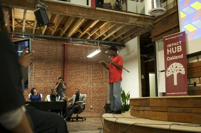 Johnnel White pitches his app to a panel of judges and community audience. (Monica Lam/KQED)