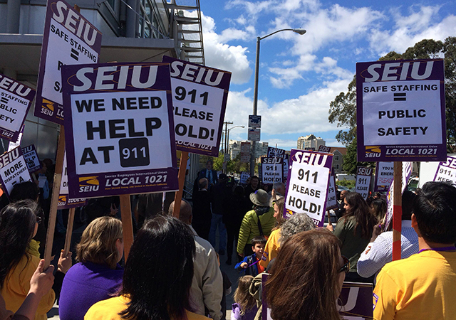 911 dispatchers and city workers rallied outside SFDEM on Wednesday (Photo by Adam Grossberg/KQED).