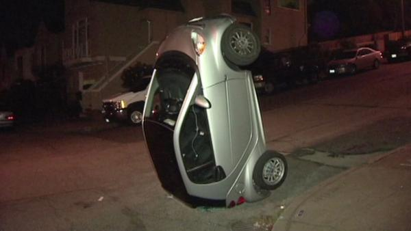 A KGO-TV image of a Smart car tipped over in San Francisco early Monday.