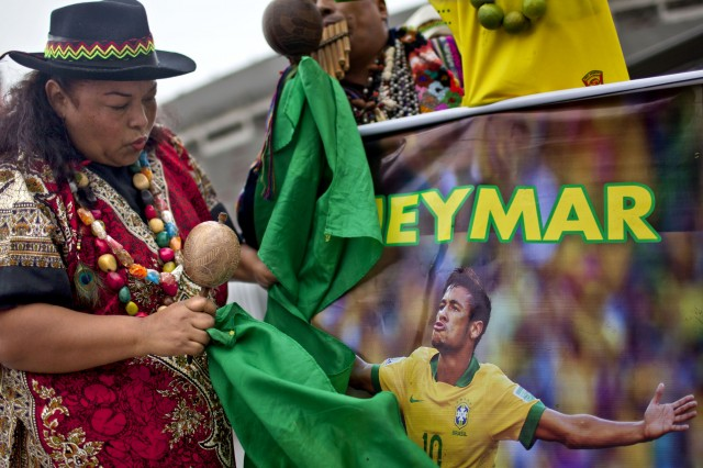 Peruvian shamans perform a ritual of predictions for the FIFA World Cup Brazil 2014 in front of the National Stadium of Peru (Ernesto Benavides/Getty Images)