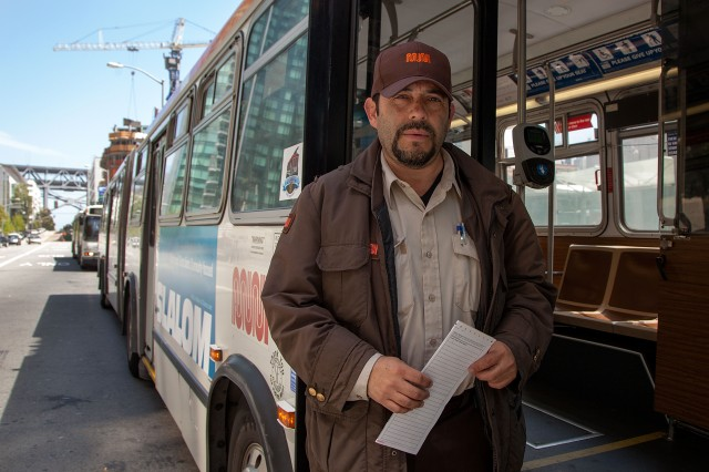 "Alex Duran has worked as a Muni driver for the past 15 years, and he's displeased with the proposed contract. ""We haven't gotten a raise for five years, but they've been raising our premium,"" he said. (Mark Andrew Boyer/KQED)"