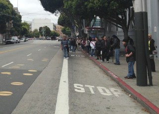 Riders faced long waits at Muni stops. (Isabel Angell/KQED)