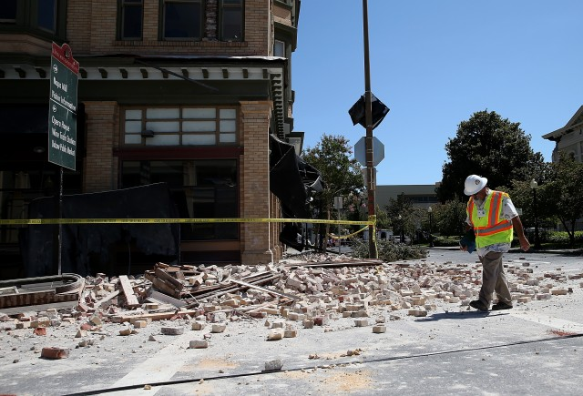 Dan Kavarian, chief building official with the City of Napa, surveys a building that was damaged by a 6.0 earthquake. (Justin Sullivan/Getty Images)