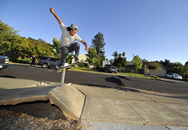 Ryan Young skateboards over a buckled sidewalk in a residential neighborhood of Napa, California. (Josh Edelson/AFP/Getty Images)
